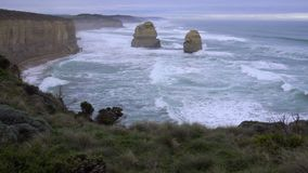Waves hitting the erosion torn cliffs Great Ocean Road. Australia stock video footage