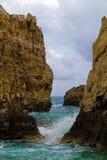 Waves hitting limestone rocks. On the shore of the Greek island Cephalonia Stock Photography