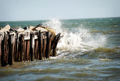 Waves hitting the pier at Sullivan Beach Island in Charleston, South Carolina. Stock Image