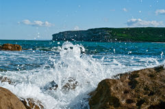 Waves hitting rocks. In tropical australia stock photos