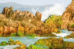 Waves hitting the rocks Royalty Free Stock Photo