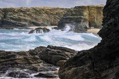 Waves hitting the coastline Stock Photos