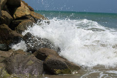 Waves hitting rocks at sea shore Royalty Free Stock Photos