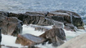 Waves Hitting Rocks Shallow Depth of Field