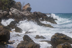 Waves hitting rocks  Stock Photo