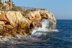 Waves hitting the rocks stock photo