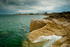 Waves hitting the shore. Foamy waves hitting the shore near Dun Laoghaire, Ireland, on a cloudy afternoon Stock Photos