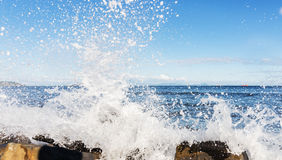 Waves hitting the shore. Stock Photo