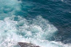 Waves hitting shore Stock Photo