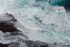 Waves hitting shore Royalty Free Stock Images