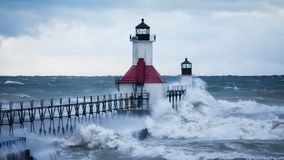 Waves hitting the St. Joseph North Pier lighthouse Royalty Free Stock Image