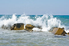 Waves hitting stones Stock Photo