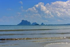 Waves hitting a tropical sandy beach in Krabi Royalty Free Stock Photography