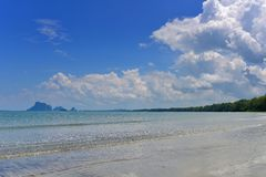 Waves hitting a tropical sandy beach in Krabi Royalty Free Stock Photo