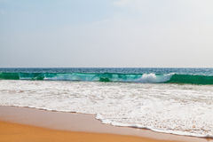 Waves of the Indian Ocean in front of the beautiful beach of Hikkaduwa Royalty Free Stock Image
