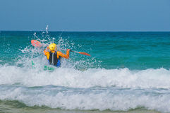 In the waves on a kayak Stock Photography