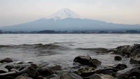 Waves on Lake Kawaguchi shoreline with Mount Fuji in background, Japan. stock video