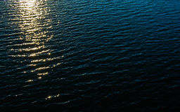 Waves in  the lake. Lake is overwhelming with waves during the sunset Stock Photo