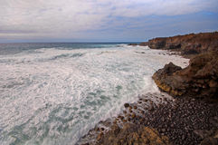 Waves on Lanzarote's volcanic coast Stock Photo