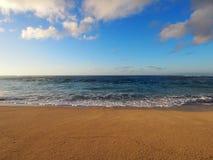 Waves lap on Sunset Beach at Dusk Royalty Free Stock Photo