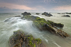 Waves lapping against rocks in Pandak Beach, Terengganu, Malaysia. Royalty Free Stock Photos