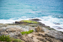 Waves lapping against rocks Stock Photo