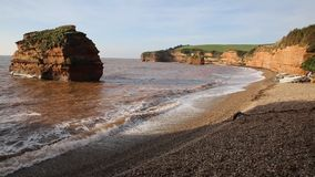 Waves lapping onto Ladram Bay beach Devon England UK stock video