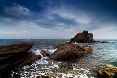Waves lapping the rocks Stock Image