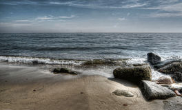 Waves lapping on a sandy beach Royalty Free Stock Photos