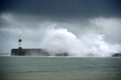 Waves. Large waves crashing over a breakwater during winter storms Stock Image