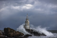 Stormy waves lighthouses Royalty Free Stock Photo