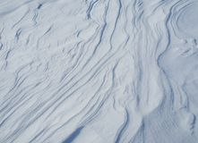 Waves and lines created by the wind on fresh snow Stock Image