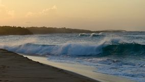 Waves during sunset at a Surfers Caribbean Beach, Puerto Rico Royalty Free Stock Images