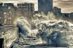 Waves of the malecon in Havana. Cuba Stock Photo