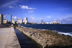 Waves in malecon of havana. Havana, Cuba seafront with waves crashing against the sea wall in front of the Malecon road Stock Photo