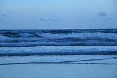 Waves massage the Florida coastline with a steady drum beat of the surf. The Boca Raton beach is comprised of miles of sandy shoreline and the occasional rock royalty free stock photography