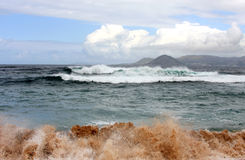 Waves mixed with sand along the spanish west coast Stock Photo