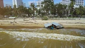 Waves Move by Rolling on Beach Dirty after Storm at Resort City. Aerial view waves move by rolling on city beach dirty after storm with garbage and broken stock video