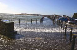 Waves at Mudeford Quay. Dorset Stock Photography