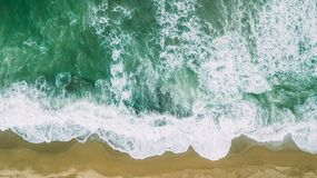 Waves near beach. Yellow sand and green water. Two Royalty Free Stock Photography