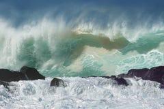 Waves north shore winter surf. Huge north shore Hawaiian waves crashing on rocks near waimea Stock Photography