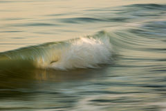Waves on the ocean captured with a slow shutter speed to bring a Royalty Free Stock Photo