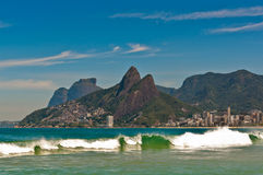 Waves in Ocean at Ipanema Beach with Mountain Landscape Royalty Free Stock Photos