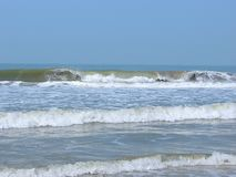 Waves in Ocean with at a Serene Beach - Payyambalam Beach, Kannur, Kerala, India. This is a photograph of sea waves at serene and clean beach, captured at Royalty Free Stock Photo