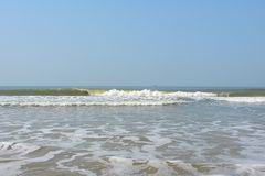 Waves in Ocean with at a Serene Beach - Payyambalam Beach, Kannur, Kerala, India. This is a photograph of sea waves at serene and clean beach, captured at Stock Photo