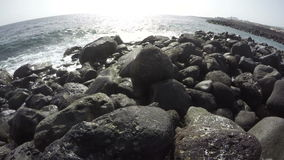 Waves on ocean shore in Tenerife on sunny day, time lapse 4K stock video footage