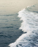 Waves in the ocean. Smooth waves rolling the the blue ocean Royalty Free Stock Photo