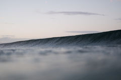 Waves in ocean at sunset Stock Photography