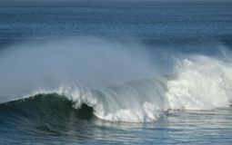 Waves with off shore wind. Waves crashing with back spray from off shore winds Huntington Beach california Stock Photos