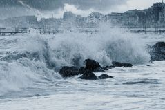 Waves om the rocks. Rain over the stormy sea Stock Photography